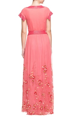 Coral and red pleated maxi dress with floral details