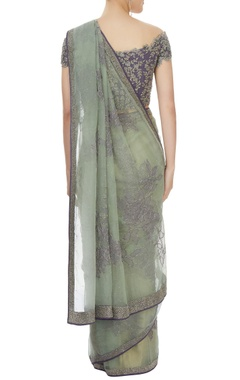 Light green sari with purple blouse