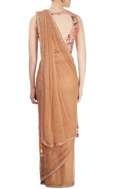 Brown sari with floral blouse