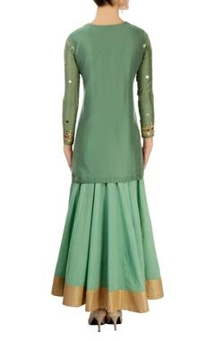 Green skirt set with mirror work