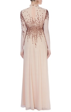 Beige high collar gown with stud details