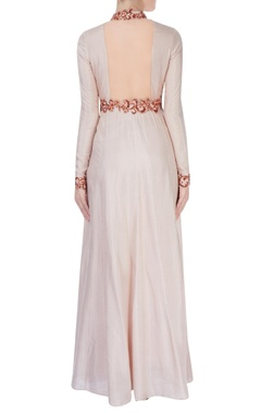 Beige high collar gown with shiny bead detailing