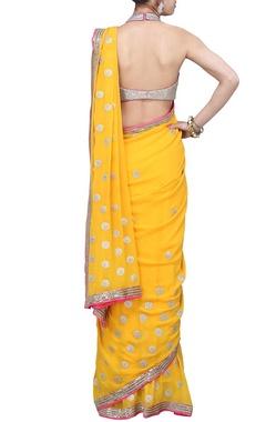 Mango yellow embroidered sari with raani pink blouse