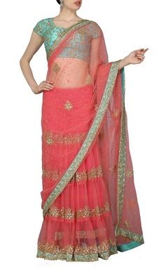 Carnation pink embellished sari with sky blue choli