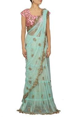 Powder blue embellished sari with pink choli