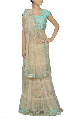 Beige embroidered sari with sky blue choli