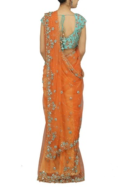Orange embroidered sari with sky blue choli