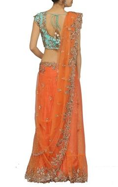 Bright orange embroidered sari with sky blue choli