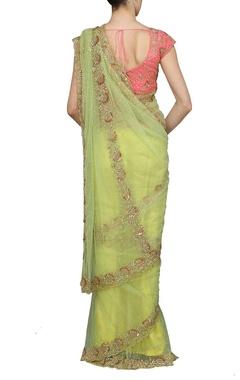 Light green embellished sari with rose pink choli