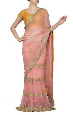 Rose pink embellished sari with haldi yellow choli