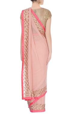 Salmon pink sari with gold motifs