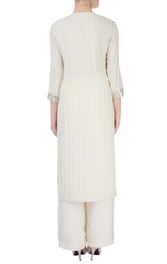 white kurta set with sequin studs