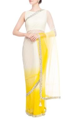 White & yellow silver sequin border sari