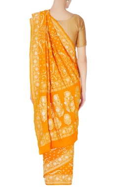 Orange sari in gold brocade detail