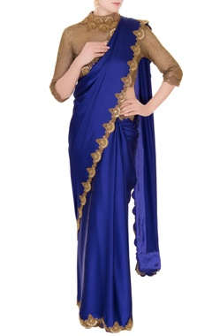 Anand Kabra Blue satin saree with zardozi cutwork blouse
