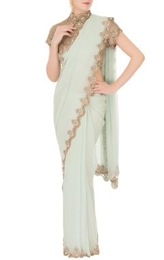 Anand Kabra Mint green georgette saree with tulle net blouse
