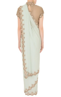 Mint green georgette saree with tulle net blouse