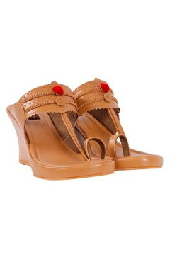 nude kolhapuri wedges with red pom-poms
