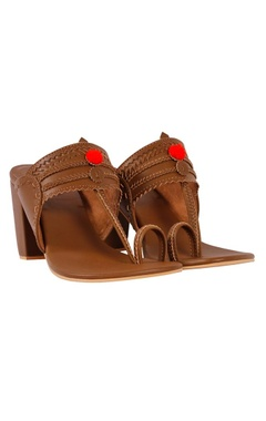 Brown kolhapuri block heels with red pom-poms