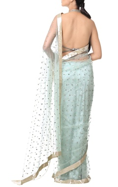powder blue sari with floral sequin embellishments
