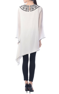 White asymmetric tunic with aztec embroidery