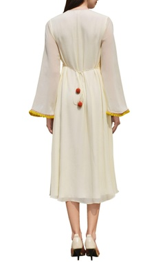 Cream dress with embroidered yoke