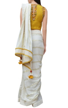 Cream striped sari with embroidered blouse