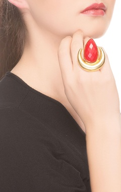 Gold moon shaped ring with red stone