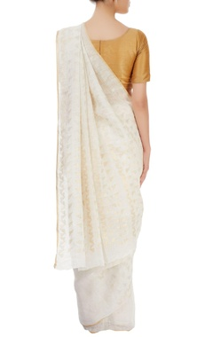 ivory sari with triangular motifs