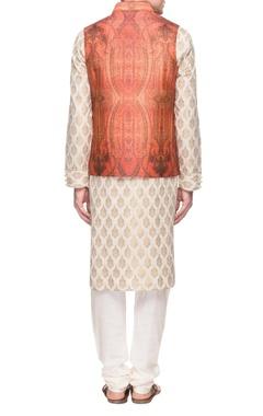 ivory kurta set with a rust orange bandi jacket