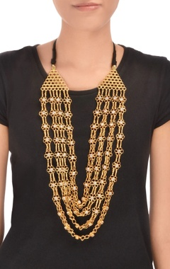 Gold plated four tiered floral long necklace