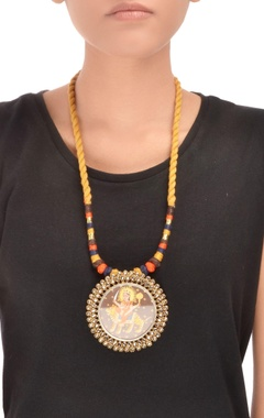 Yellow thread necklace with goddess Durga pendant