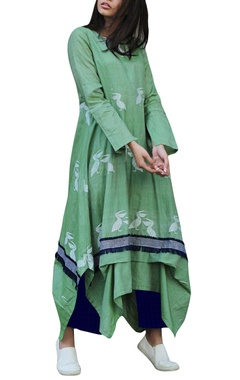 Pistachio green dress with indigo pants