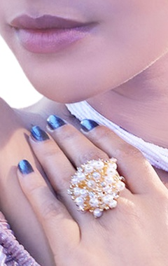 Gold plated ring with pearls