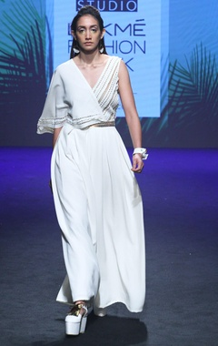 White cutwork jumpsuit with box pleats