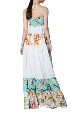 White maxi dress with floral and pastel accents
