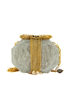 Ivory clutch with molten stones