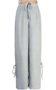 Light blue trousers with tie-up details