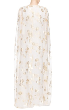 Ivory printed gown with dramatic sleeves