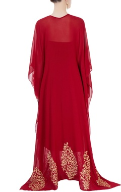 Red kaftan-style dress with embellishments