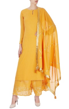 Mustard yellow kurta set with line detailing
