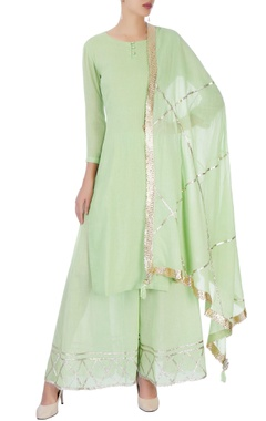 Green kurta set with line detailing