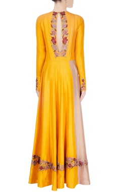 Yellow embroidered anarkali features shiny embroidered patches in select places