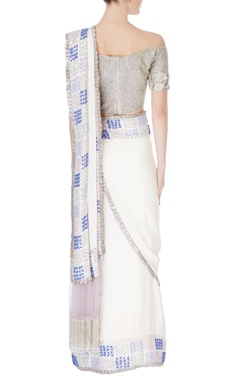 White sari in silver sequin work