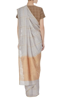Icy blue linen hand woven check saree with unstitched blouse