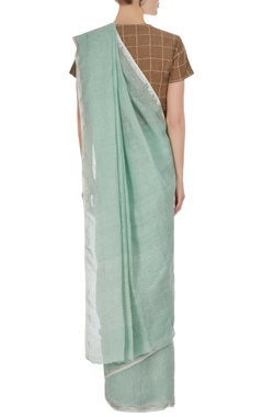 Soft pine green hand-woven linen saree