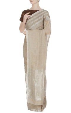 Anavila Beige linen hand woven saree with silver border & unstitched blouse