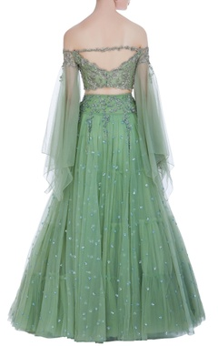 Off-shoulder blouse with super flared organza lehenga