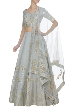 Matsya Gota embroidered lehenga with choli and net dupatta.