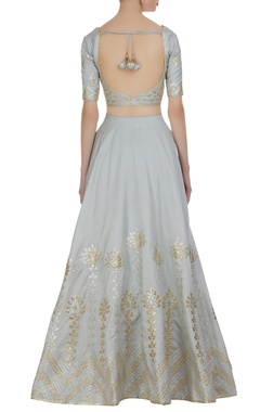 Gota embroidered lehenga with choli and net dupatta.